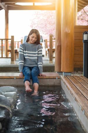 onsen: Woman enjoy onsen on feet