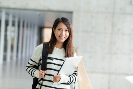 campus building: Asian student inside campus building
