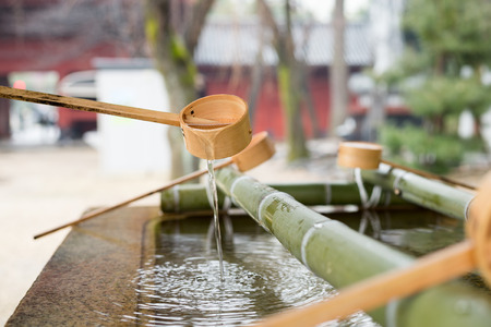 purification: Japanese Purification Fountain in Shinto Temple Stock Photo