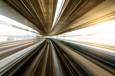 though: Monorail passing though the tunnel Stock Photo