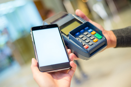 mobile telephone: Customer using mobile phone for payment