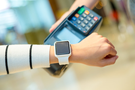 rfid: Woman using smart watch to pay Stock Photo
