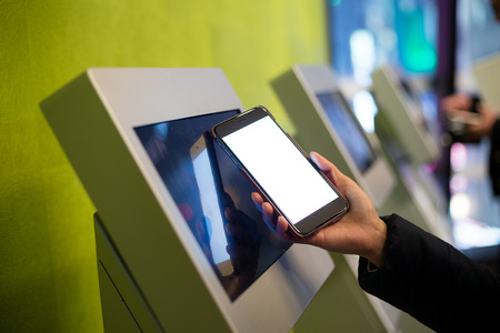 ticketing: Woman using the ticketing system by cellphone with NFC technology