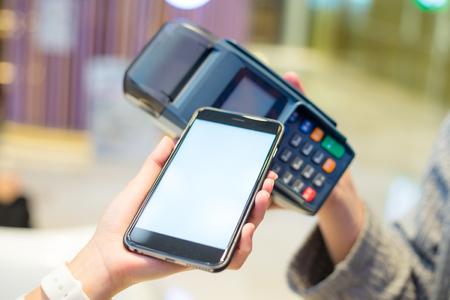 checkout: Woman using cellphone to checkout