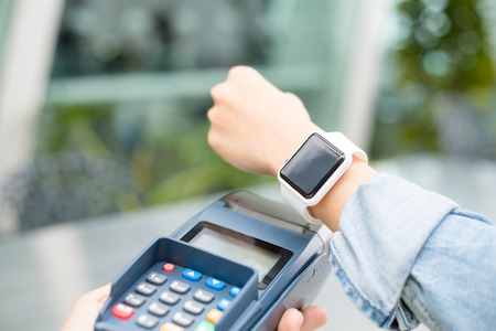 bangles hand: Woman using wearable watch to pay