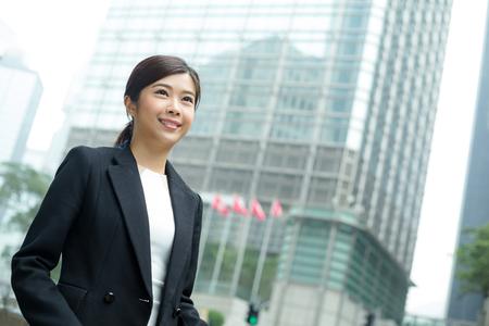 far away look: Young Businesswoman look far away