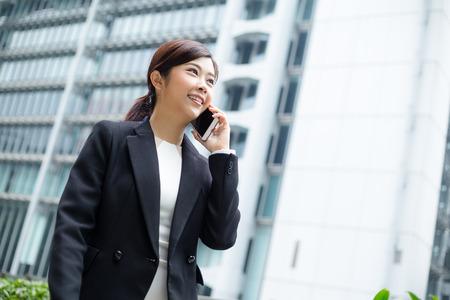 far away look: Businesswoman talk to mobile phone
