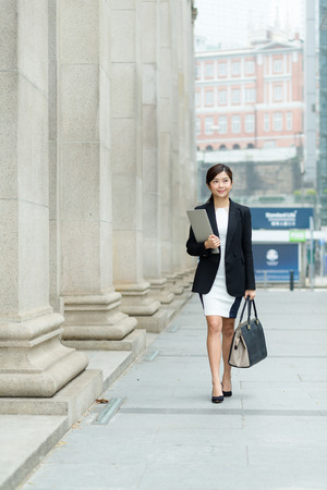 though: Young Businesswoman passing though the street