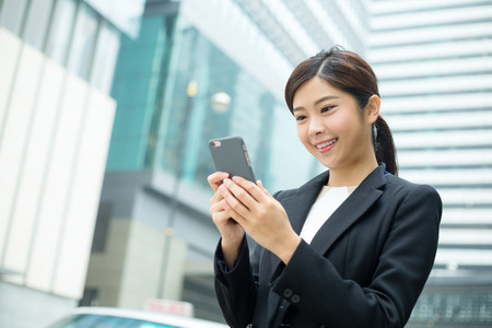 office use: Business woman use of cellphone Stock Photo