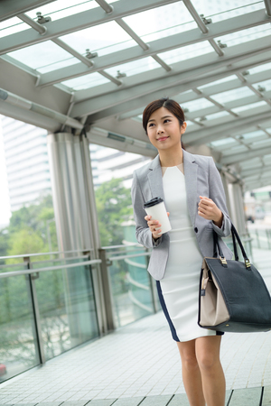 people relax: Businesswoman walking at street