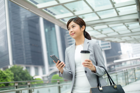 Asian Businesswoman hold with cellphone 免版税图像