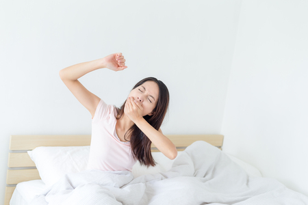 tried: Woman feeling tried at bed Stock Photo