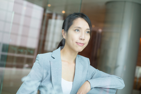 building planners: Business woman inside office building Stock Photo