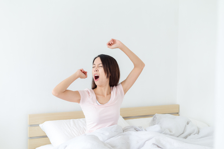 tried: Woman wake up at morning and hand stretching