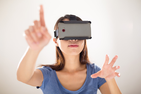 experiencing: Woman wearing VR device Stock Photo
