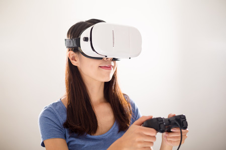 though: Woman looking though VR device with joystick