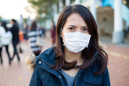 transmissible: Woman wearing medical mask Stock Photo