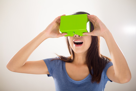experiencing: Excited Woman using virtual reality
