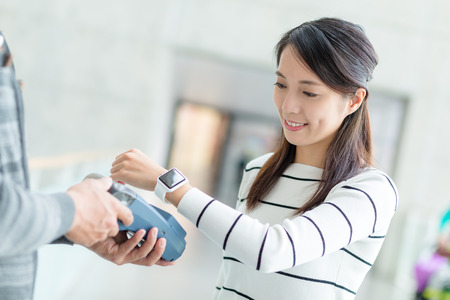 nfc: Woman pay by NFC on smartwatch