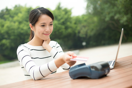 commercial tree service: Woman pay with credit card