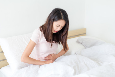 Asian Woman suffer from stomach pain Фото со стока - 55566365