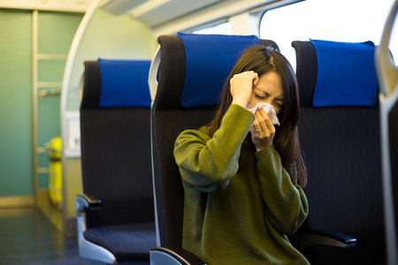 compartment: Woman feeling unwell in train compartment