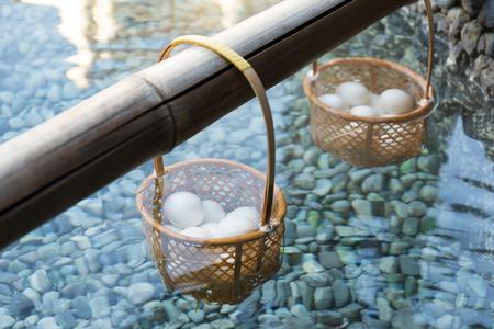 Japanese hot spring steam boil eggs inside basket Stock Photo