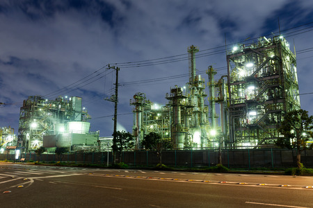 paesaggio industriale: Industrial landscape with chimneys tank at night