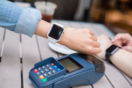 nfc: Woman using smart watch with NFC technology Stock Photo