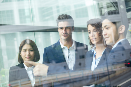 discuss: Group of business people discuss something inside office Stock Photo