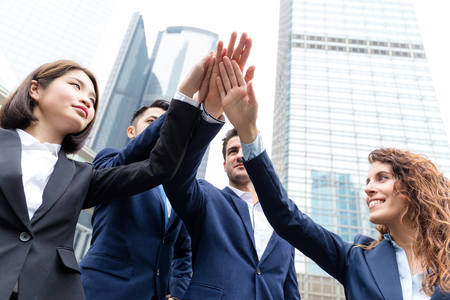 happy business team: Group of business people joining hand