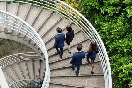 up stair: Top view of business people going up stair Stock Photo