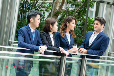 buisness woman: Group of business people talking to each other outside office