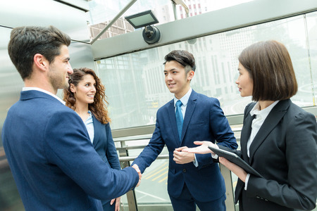 discuss: Group of business people discuss each other Stock Photo