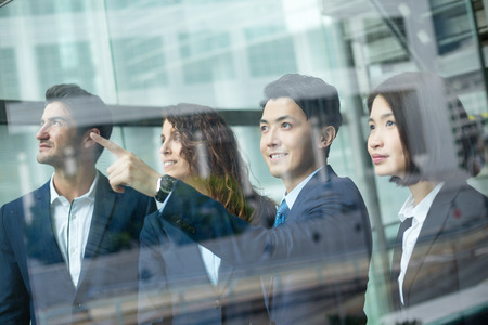 discuss: Group of business people discuss about the project inside office Stock Photo
