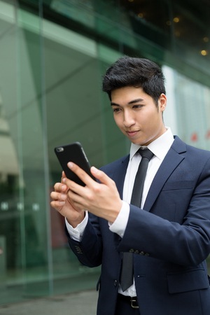 telephone salesman: Business man sending sms Stock Photo