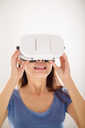 though: Woman looking though the scary movie with virtual reality