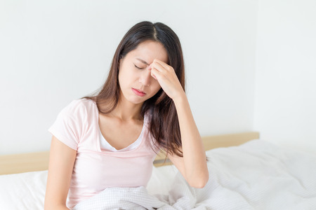 Woman feeling eye pain 免版税图像