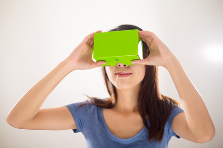 visualizing: Woman happy looking with virtual reality