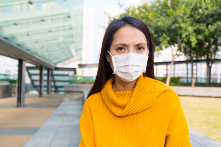 protective: Woman wearing protective mask
