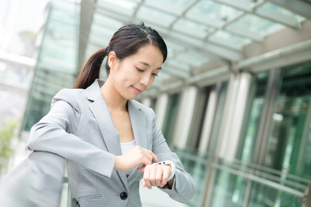 buisness: Buisness woman use of smart watch