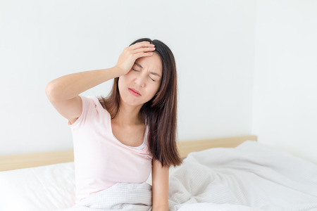 Sick woman on the bed at home 免版税图像