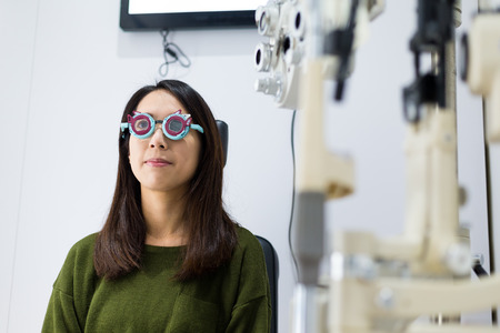 visual therapy: Woman checking on her eye in optical clinic