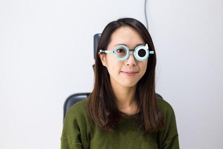 getting: Woman getting eye exam