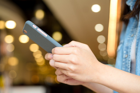 body parts cell phone: Woman hold with cellphone Stock Photo