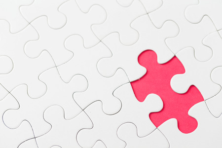 missing piece: Puzzle with missing piece in red color Stock Photo