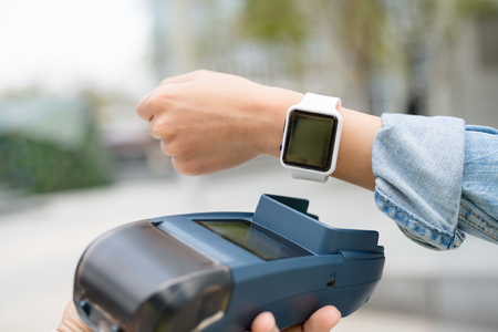 wireless terminals: Customer using wearable watch to checkout