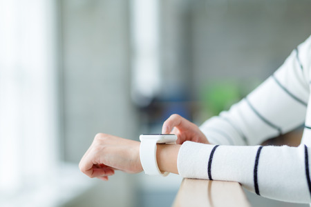 hall monitors: Woman use of wearable smartwatch