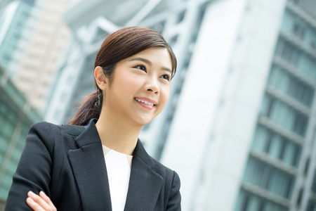 far away look: Young Businesswoman Stock Photo