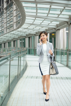 phone business: Business woman on smart phone